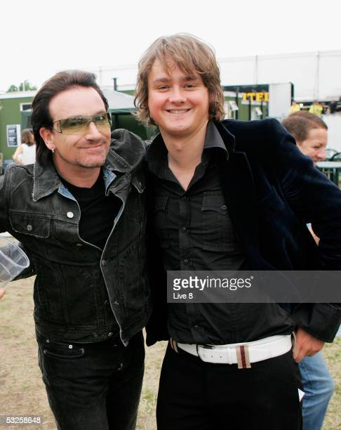 "Musicians Bono of U2 and Tom Chaplin of Keane are seen backstage at ""Live 8 London"" in Hyde Park on July 2, 2005 in London, England. The free concert..."