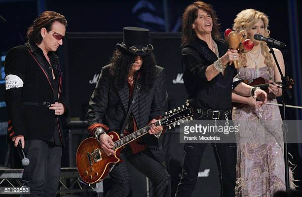 Musicians Bono Slash Steven Tyler and Allison Krauss perform 'Across The Universe' in the tsunami relief peformance on stage during the 47th Annual...