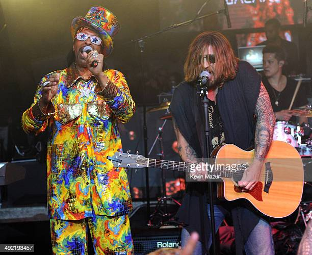Musicians Bootsy Collins and Billy Ray Cyrus perform onstage during the 2014 Billboard Music Awards AfterParty sponsored by Citi at The Light at...