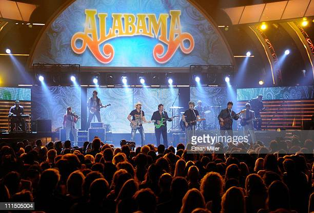Musicians Brad Paisley and Jeff Cook Randy Owen and Teddy Gentry from the band Alabama perform onstage at the 46th Annual Academy of Country Music...