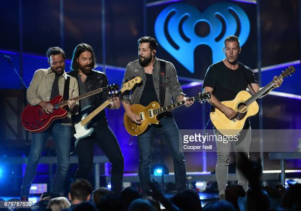 Musicians Brad Tursi Geoff Sprung Matthew Ramsey and Trevor Rosen of Old Dominion perform onstage during the 2017 iHeartCountry Festival A Music...