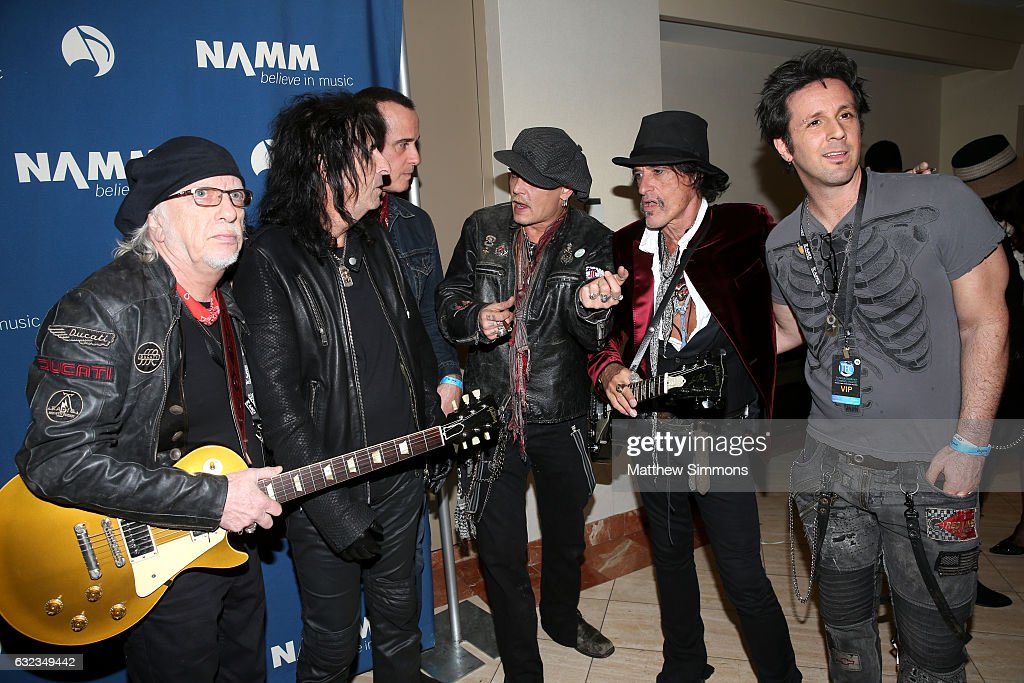 Musicians Brad Whitford, Alice Cooper, Robert DeLeo, Johnny Depp, Joe Perry and Glen Sobel pose for a photograph backstage at the TEC Awards during NAMM Show 2017 at the Anaheim Hilton on January 21, 2017 in Anaheim, California.