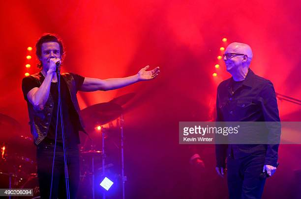 Musicians Brandon Flowers and Neil Tennant perform onstage at The Wiltern on September 26 2015 in Los Angeles California