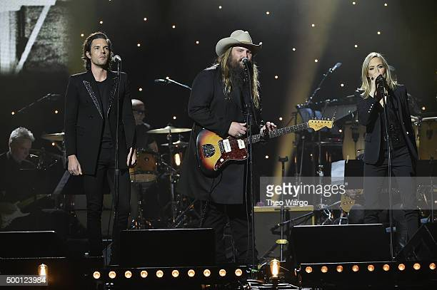 Musicians Brandon Flowers Chris Stapleton and Sheryl Crow perform on stage during the Imagine John Lennon 75th Birthday Concert at The Theater at...