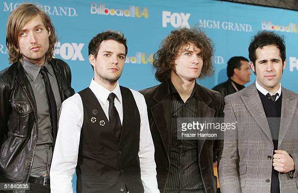 Musicians Brandon Flowers David Keuning Mark Stoermer and Ronnie Vannucci of The Killers arrive at the 2004 Billboard Music Awards on December 8 2004...