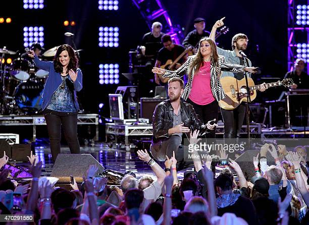 Musicians Brandy Clark Charles Kelley Hillary Scott and Dave Haywood of Lady Antebellum perform onstage during ACM Presents Superstar Duets at Globe...