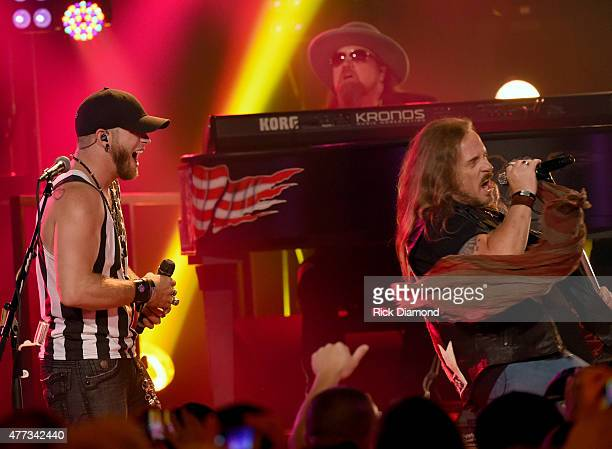 Musicians Brantley Gilbert and Johnny Van Zant perform onstage during CMT Crossroads Lynyrd Skynyrd and Brantley Gilbert premiering Saturday June...