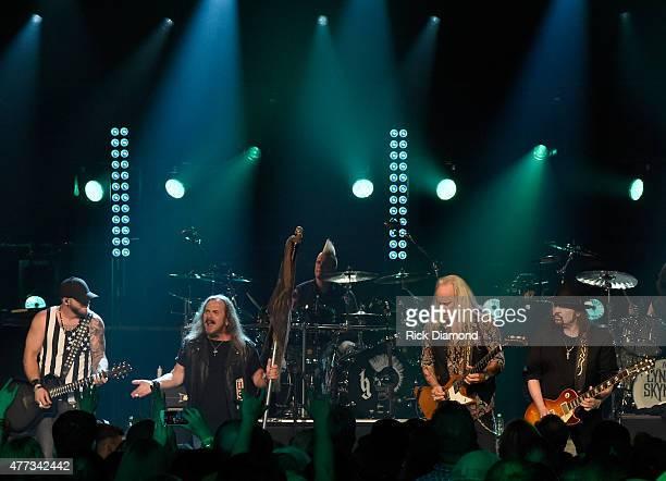 Musicians Brantley Gilbert Johnny Van Zant Rickey Medlocke and Gary Rossington perform onstage during CMT Crossroads Lynyrd Skynyrd and Brantley...