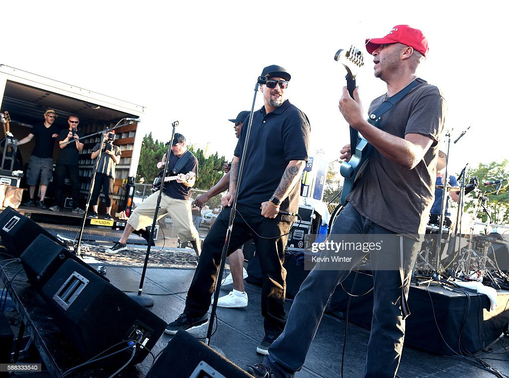 Musicians B-Real (L) and Tom Morello of Prophets of Rage perform outside of the California Rehabilitation Center on August 10, 2016 in Norco, California.