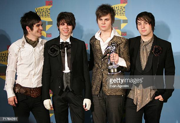Musicians Brendon Urie Ryan Ross Spencer Smith and Jon Walker of Panic At The Disco pose in the press room with their award for Video of the Year for...