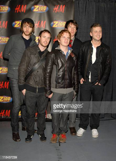 Musicians Brent Kutzle Eddie Fisher Drew Brown Zach Filkins and Ryan Tedder of OneRepublic pose for a photo in the press room during Z100's Jingle...