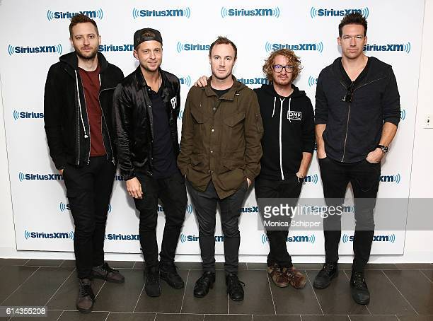 Musicians Brent Kutzle Ryan Tedder Eddie Fisher Drew Brown and Zach Filkins of band OneRepublic visit SiriusXM Studio on October 13 2016 in New York...