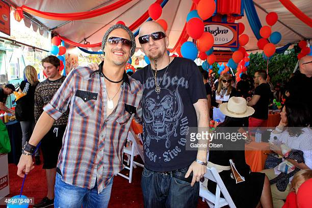 Musicians Brett Scallions and Shavo Odadjian attend the John Varvatos 11th Annual Stuart House Benefit at John Varvatos Boutique on April 13 2014 in...