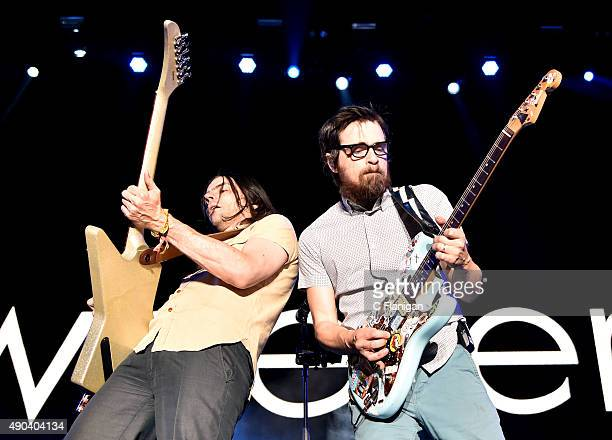Musicians Brian Bell and Rivers Cuomo of Weezer perform onstage during the 2015 Life is Beautiful festival on September 27 2015 in Las Vegas Nevada