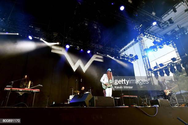 Musicians Brian Bell Patrick Wilson Rivers Cuomo and Scott Shriner of musical group Weezer perform on The Oak stage during Arroyo Seco Weekend at the...