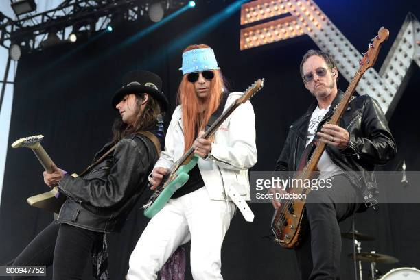 Musicians Brian Bell Rivers Cuomo and Scott Shriner of Weezer perform onstage during Arroyo Seco Weekend at Brookside Golf Course on June 25 2017 in...