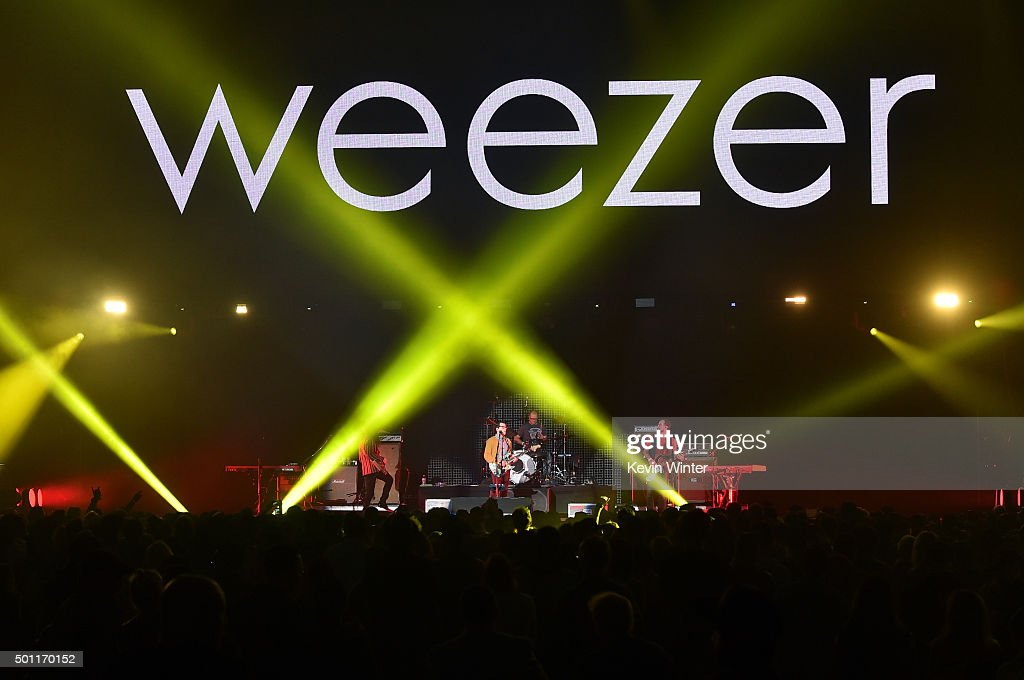 Musicians Brian Bell, Rivers Cuomo, Patrick Wilson and Scott Shriner of Weezer perform onstage during 106.7 KROQ Almost Acoustic Christmas 2015 at The Forum on December 12, 2015 in Los Angeles, California.