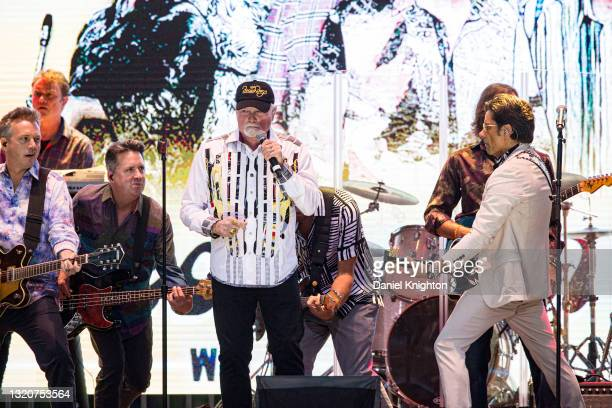 Musicians Brian Eichenberger, Tim Bonhomme, Keith Hubacher, Mike Love, Christian Love, John Stamos, and Scott Totten of The Beach Boys perform on...