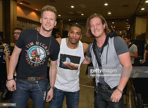 Musicians Brian Kelley and Tyler Hubbard of Florida Georgia Line and recording artist Nelly attend Tim McGraw's Superstar Summer Night presented by...