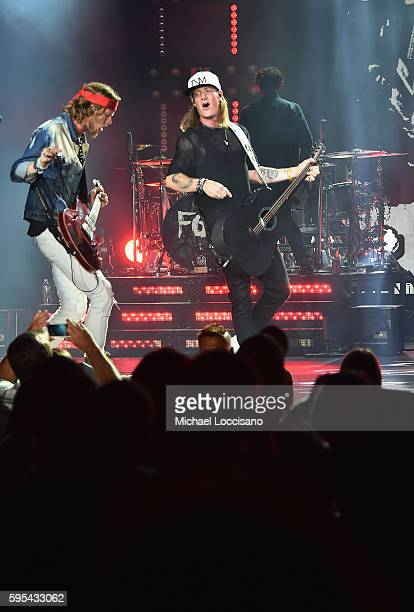 """Musicians Brian Kelley and Tyler Hubbard of Florida Georgia Line perform during their """"Dig Your Roots"""" 2016 tour at The Theater at Madison Square..."""