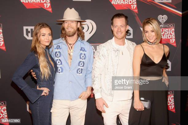 Musicians Brian Kelley and Tyler Hubbard of Florida Georgia Line with Brittney Marie Cole and Hayley Stommel attend the 2017 iHeartRadio Music Awards...