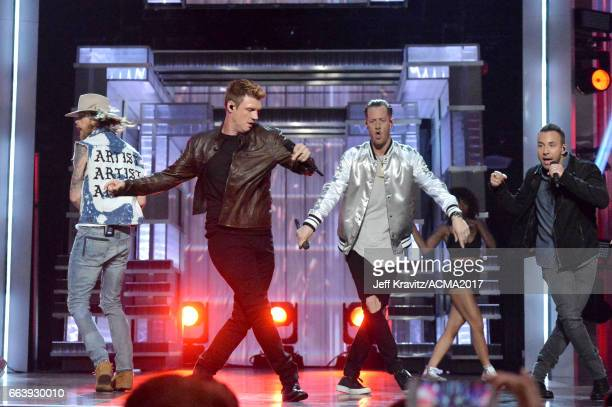 Musicians Brian Kelley of Florida Georgia Line Nick Carter of The Backstreet Boys Tyler Hubbard of Florida Georgia Line and Howie Dorough of The...