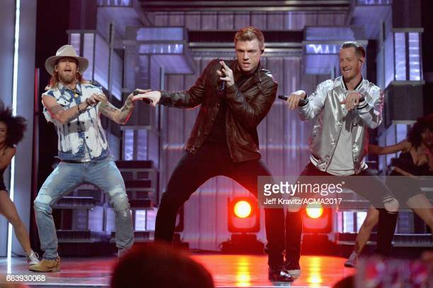 Musicians Brian Kelley of Florida Georgia Line Nick Carter of The Backstreet Boys and Tyler Hubbard of Florida Georgia Line perform onstage at the...