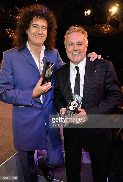 Musicians Brian May and Roger Taylor from Queen with their Ambassadors of Rock award during the O2 Silver Clef Awards 2009 at the London Hilton on...