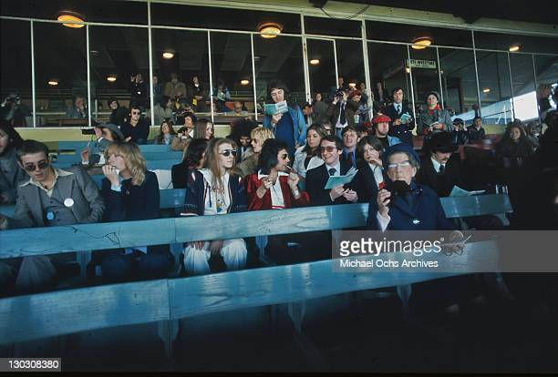 Musicians Brian May John Deacon Roger Taylor and Freddie Mercury of British rock band Queen at Kempton Park Racecourse in Surrey to promote their...