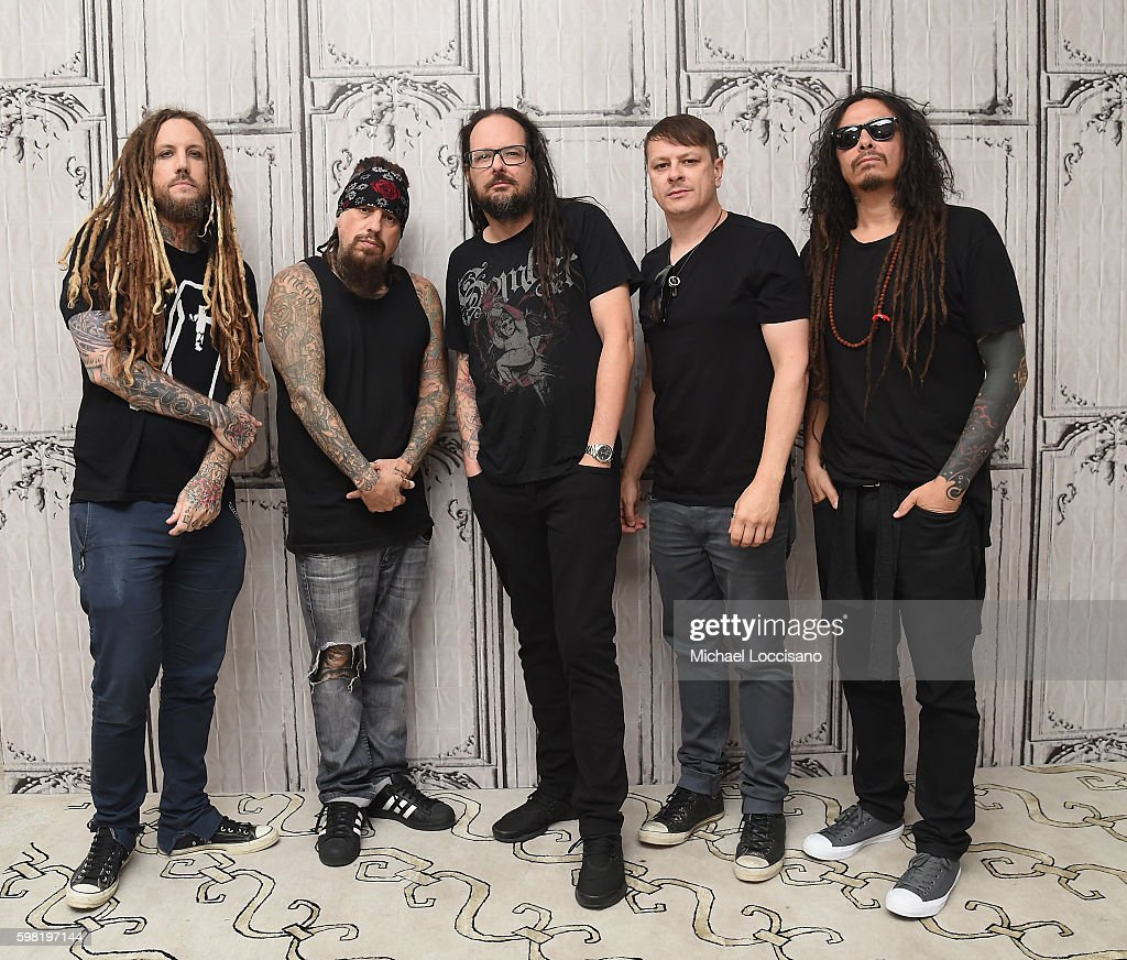 Musicians Brian Welch, Reginald 'Fieldy' Arvizu, Jonathan Davis, Ray Luzier and James 'Munky' Shaffer of Korn attend the BUILD Series to discuss the band's newest studio album 'The Serenity Of Suffering' at AOL HQ on August 31, 2016 in New York City.