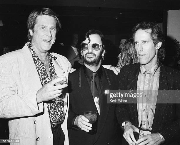 Musicians Brian Wilson, Ringo Starr and John Densmore at a party, circa 1990.