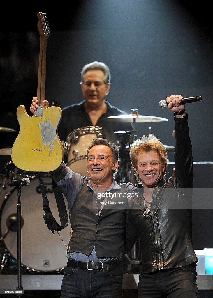 Musicians Bruce Springsteen (L) and Jon Bon Jovi perform at '12-12-12' a concert benefiting The Robin Hood Relief Fund to aid the victims of Hurricane Sandy presented by Clear Channel Media & Entertainment, The Madison Square Garden Company and The Weinstein Company at Madison Square Garden on December 12, 2012 in New York City.