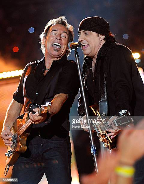 Musicians Bruce Springsteen and Steven Van Zandt of the E Street Band perform at the Bridgestone halftime show during Super Bowl XLIII between the...