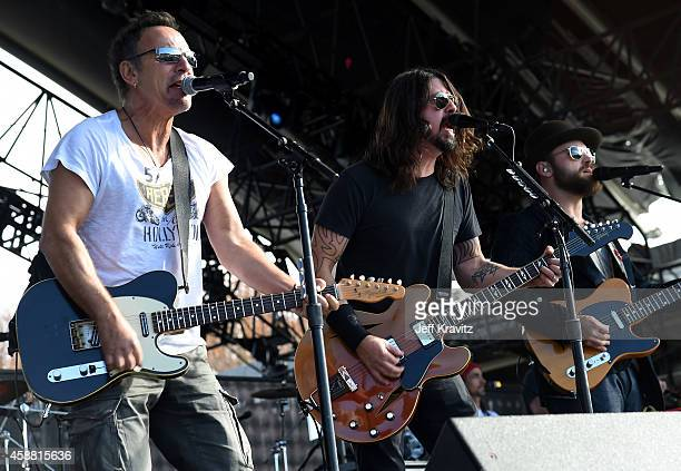 Musicians Bruce Springsteen Dave Grohl and Zac Brown perform on stage during 'The Concert For Valor' at The National Mall on November 11 2014 in...