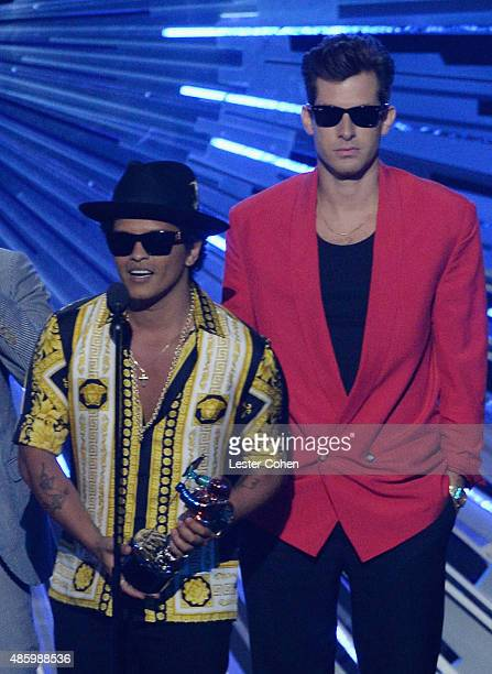 Musicians Bruno Mars and Mark Ronson speak onstage during the 2015 MTV Video Music Awards at Microsoft Theater on August 30 2015 in Los Angeles...