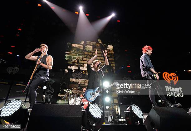 Musicians Calum Hood, Ashton Irwin, Luke Hemmings and Michael Clifford of 5 Seconds of Summer perform onstage during 106.1 KISS FM's Jingle Ball 2015...