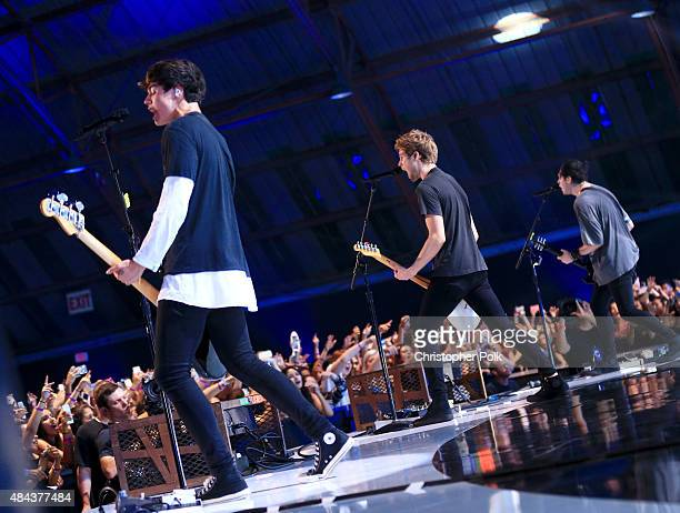 Musicians Calum Hood Luke Hemmings and Michael Clifford of 5 Seconds Of Summer perform nstage during Vevo Certified Live at Barker Hangar on August...