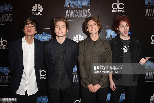 Musicians Calum Hood Luke Hemmings Ashton Irwin and Michael Clifford of 5 Seconds of Summer attend the PEOPLE Magazine Awards at The Beverly Hilton...