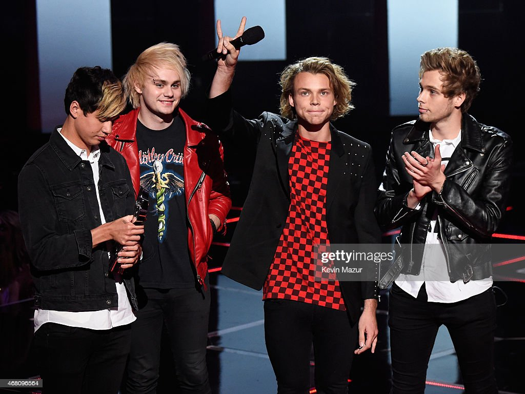 Musicians Calum Hood, Michael Clifford, Ashton Irwin, and Luke Hemmings of 5 Seconds of Summer accept the Best Fan Army award onstage during the 2015 iHeartRadio Music Awards which broadcasted live on NBC from The Shrine Auditorium on March 29, 2015 in Los Angeles, California.