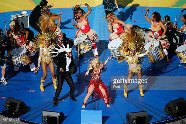 Musicians Carlinhos Brown and Shakira perform during the closing ceremony prior to the 2014 FIFA World Cup Brazil Final match between Germany and...