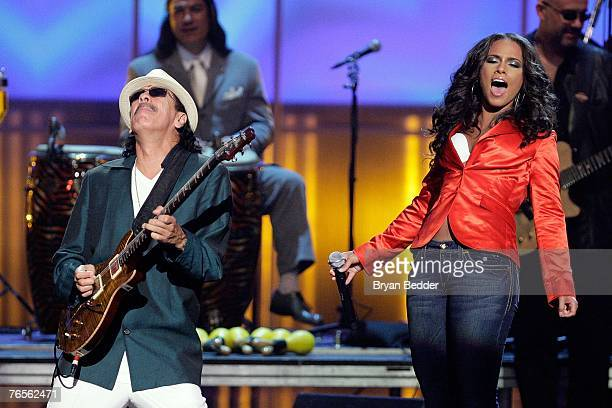 Musicians Carlos Santana and Alicia Keys performs onstage at the Conde Nast Media Group's Fourth Annual Fashion Rocks Concert at Radio City Music...
