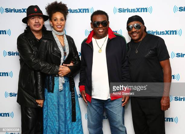 Musicians Carlos Santana and wife Cindy Blackman pose for photos with Ronald Isley and Ernie Isley at the SiriusXM Studios on August 2 2017 in New...