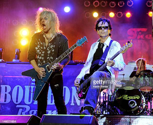 """Musicians C.C. DeVille and Bobby Dall of Poison perform at the after party for the premiere of Warner Bros. Pictures' """"Rock Of Ages"""" at Hollywood and..."""