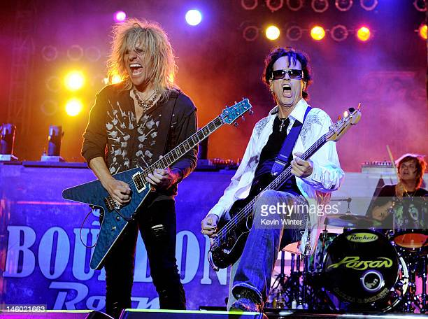 Musicians CC DeVille and Bobby Dall of Poison perform at the after party for the premiere of Warner Bros Pictures' Rock Of Ages at Hollywood and...