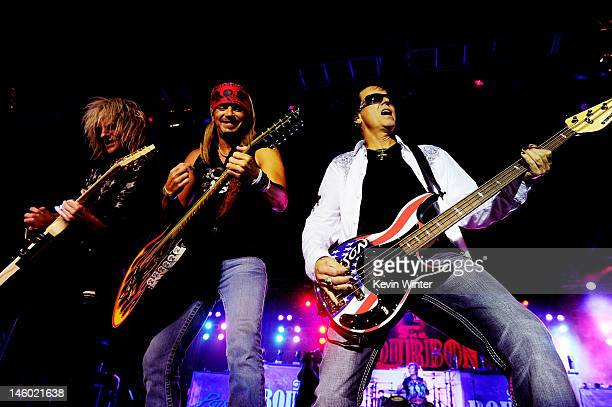 Musicians CC DeVille Bret Michaels and Bobby Dall of Poison perform at the after party for the premiere of Warner Bros Pictures' Rock Of Ages at...