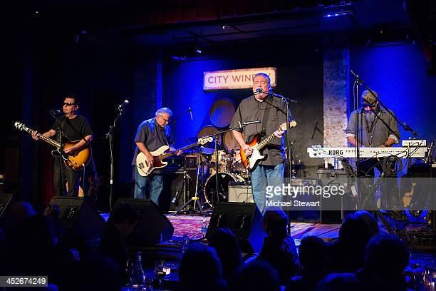 Musicians Cesar Rosas Conrad Lozano David Hidalgo and Steve Berlin of Los Lobos perform at City Winery on November 30 2013 in New York City