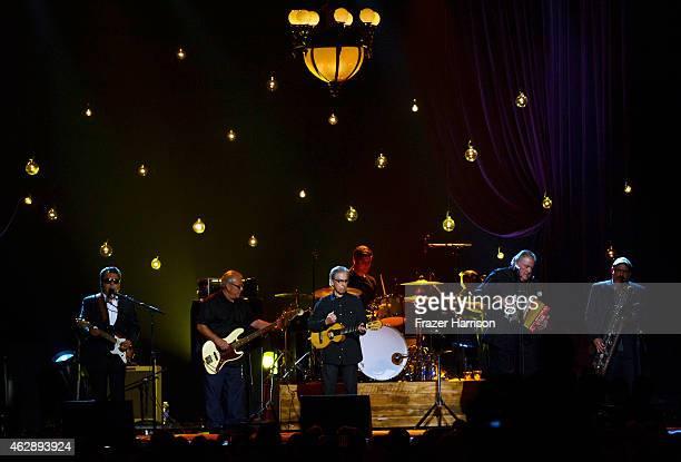 Musicians Cesar Rosas Conrad Lozano Louie Perez David Hidalgo and Steve Berlin of Los Lobos perform onstage at the 25th anniversary MusiCares 2015...