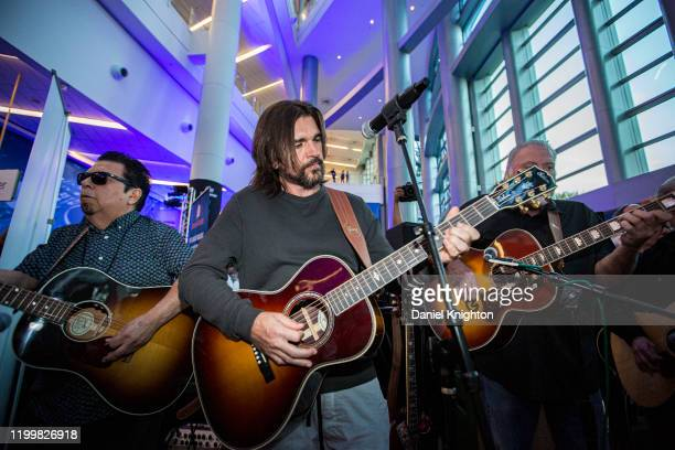 Musicians Cesar Rosas Juanes and David Hidalgo perform during The NAMM Show 2020 Media Preview Day at Anaheim Convention Center on January 15 2020 in...
