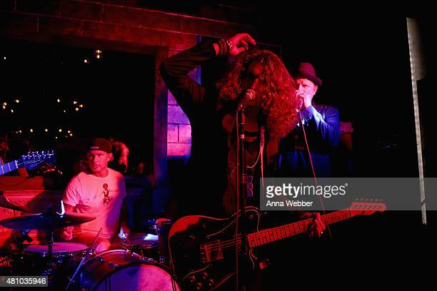 Musicians Chad Smith Andrew Watt and Danny Clinch perform on stage at the John Varvatos fashion show after party at The Electric Room on July 17 2015...