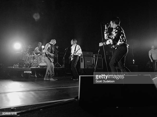 Musicians Chad Smith Flea Josh Klinghoffer and Anthony Kiedis of the Red Hot Chili Peppers perform onstage during the 'Feel the Bern' fundraiser for...